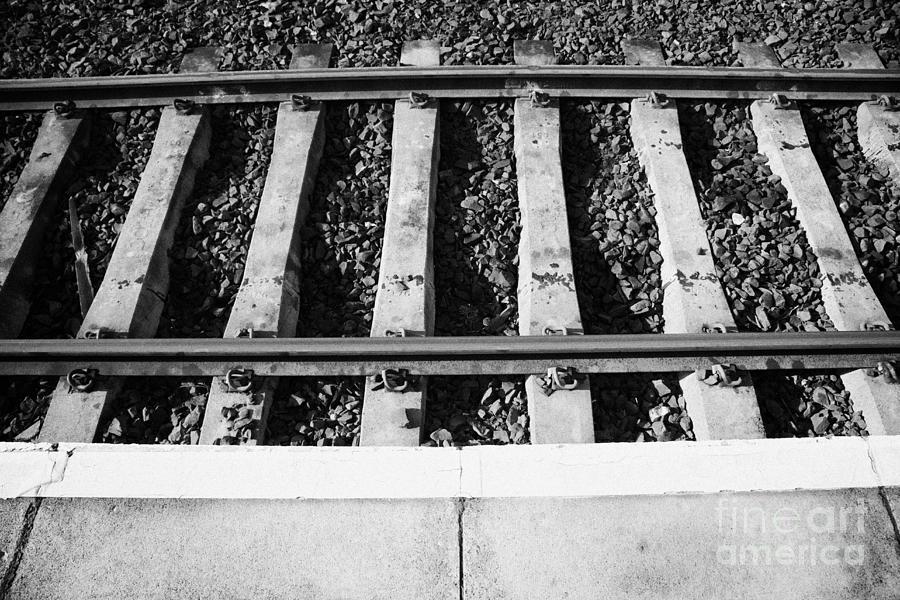 Railway Photograph - Edge Of Railway Station Platform And Track Northern Ireland Uk by Joe Fox