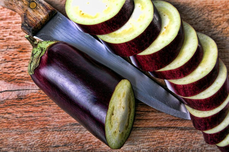 Agriculture Photograph - Eggplant Sliced by Roberto Giobbi