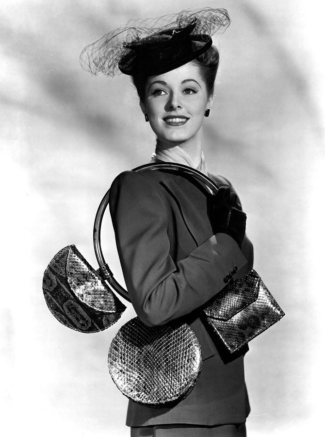 1940s Portraits Photograph - Eleanor Parker Carrying 3 Small by Everett