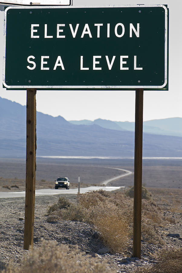 Signs Photograph - Elevation Sea Level Sign And Highway by Rich Reid