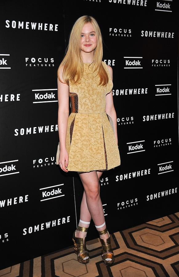 Elle Fanning Photograph - Elle Fanning Wearing A Rodarte Dress by Everett