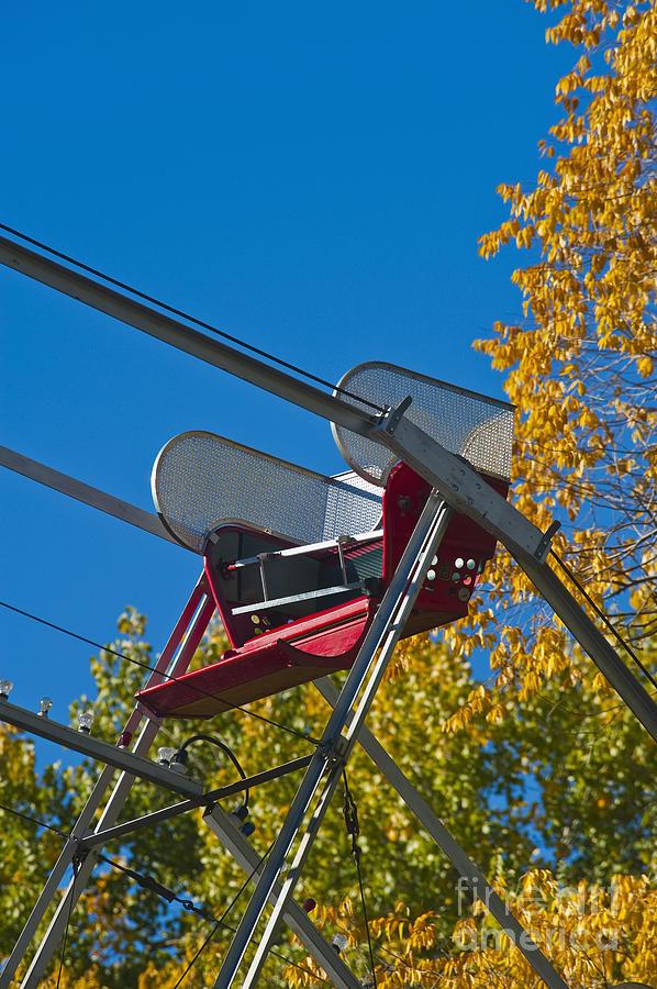 Amusement Photograph - Empty Chair On Ferris Wheel by Thom Gourley/Flatbread Images, LLC