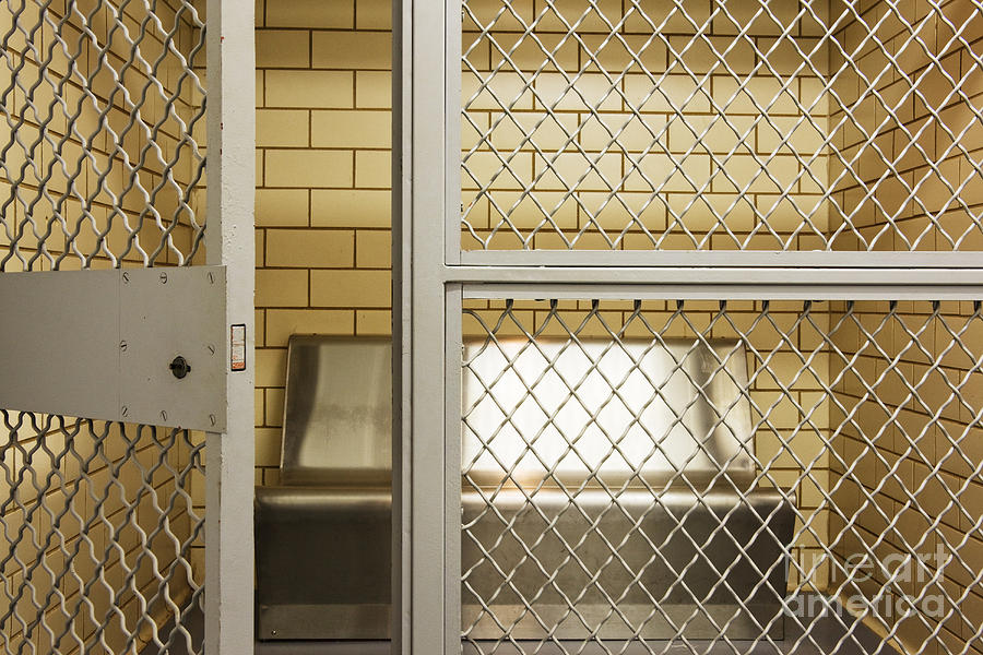 Architecture Photograph - Empty Jail Holding Cell by Jeremy Woodhouse