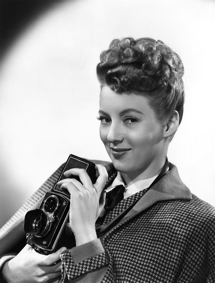 1940s Hairstyles Photograph - Evelyn Keyes, With A Rolex Camera, Ca by Everett
