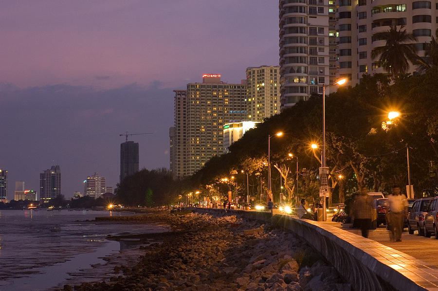 Horizontal Photograph - Evening Falls Over Water Front Buildings by Austin Bush