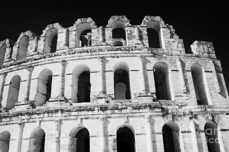 Tunisia Photograph - External View Of Three Upper Tiers Of Archways Of Old Roman Colloseum El Jem Tunisia by Joe Fox
