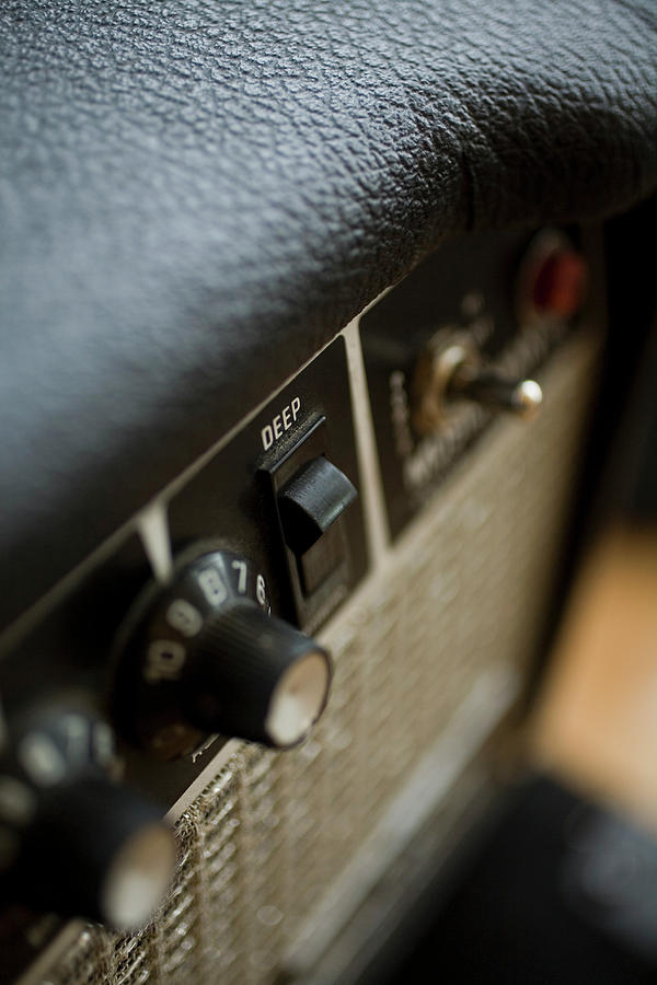 Vertical Photograph - Extreme Close-up Angled Shot Of An Amplifier by Christopher Kontoes