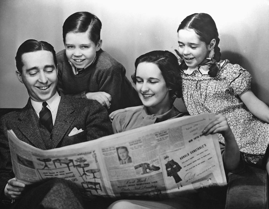 Child Photograph - Family Reading Newspaper by George Marks