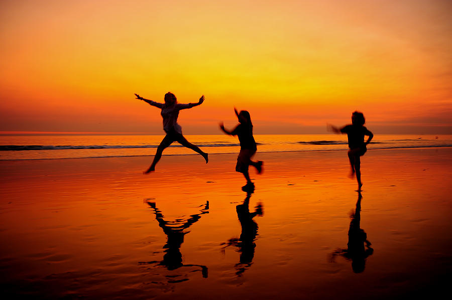 Family Running At The Beach At Sunset Photograph by Jorge Fajl
