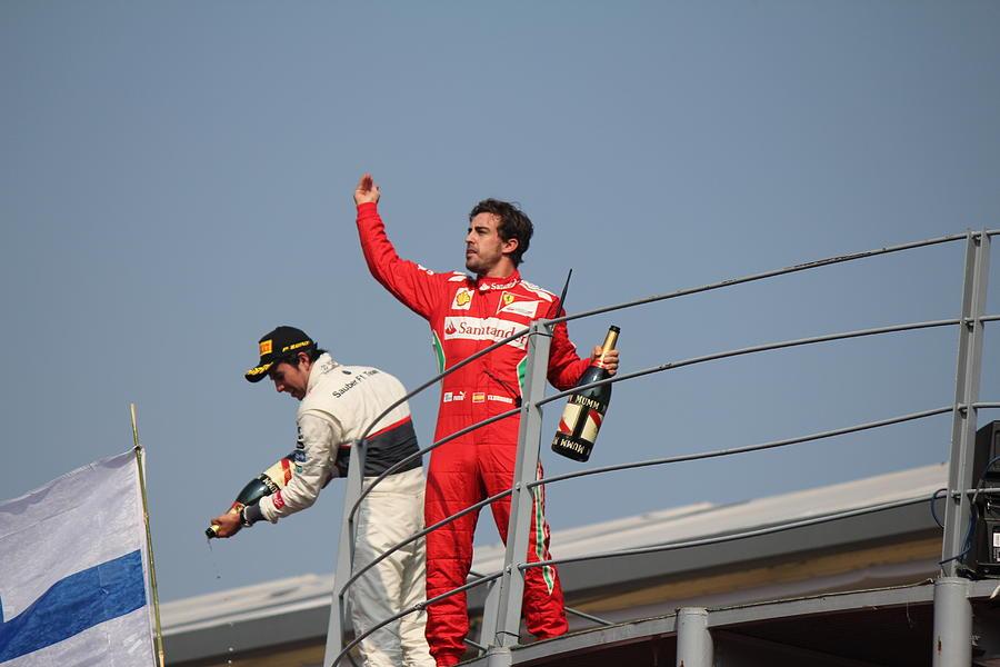 Fernando Alonso Photograph - Fernando Alonso And Sergio Perez by David Grant