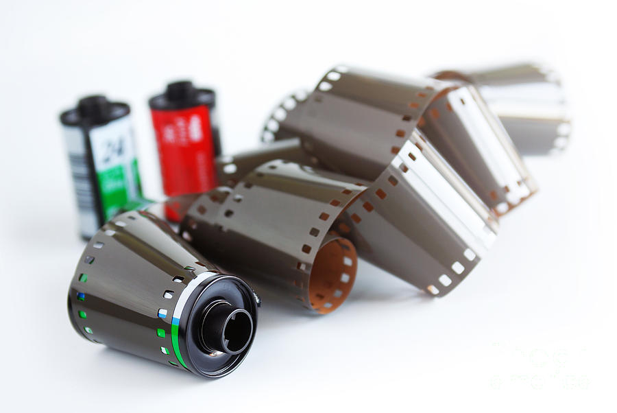 35mm Photograph - Film And Canisters by Carlos Caetano