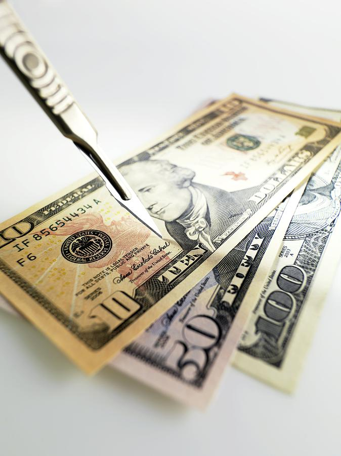 Adversity Photograph - Financial Cuts by Tek Image