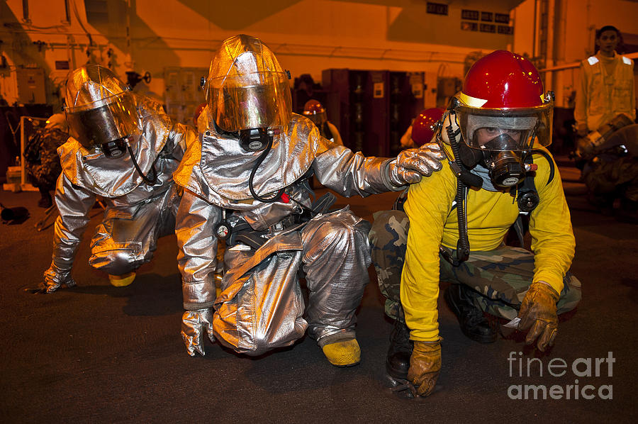 Crouching Photograph - Firemen Brace For Shock by Stocktrek Images