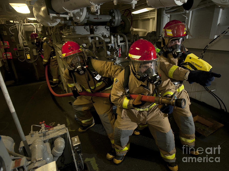 Warship Photograph - Firemen Combat A Simulated Fire Aboard by Stocktrek Images