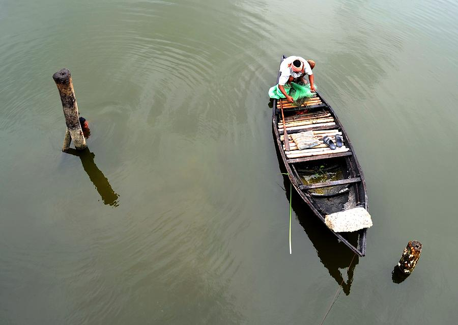 Child Photograph - Fisherman And His Boat by Pallab Seth