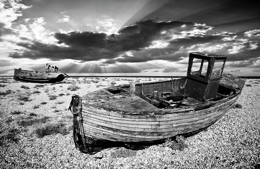 Fishing boat graveyard photograph by meirion matthias for Fishing boat dealers near me