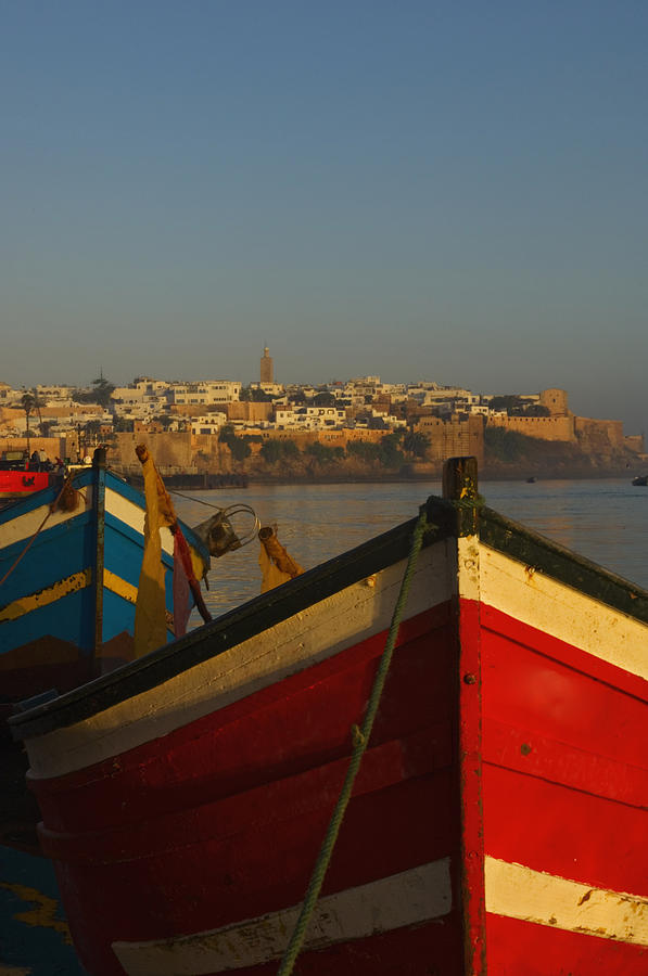 No People Photograph - Fishing Boats In Front Of Kasbah Des by Axiom Photographic
