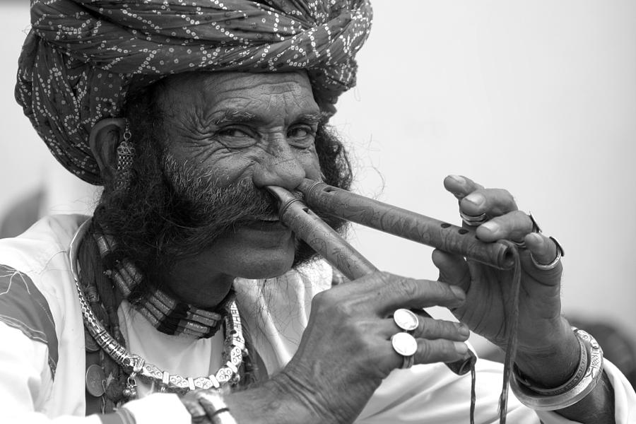 Flute Player Photograph - Flute Player from India by Karan Anand
