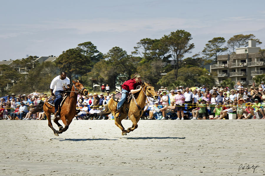 Beach Photograph - Flying At The Marsh Tacky Races by Phill Doherty