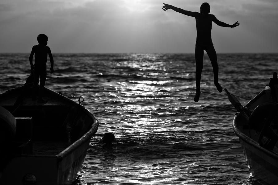 Black Photograph - Flying Kids by Victor Bezrukov