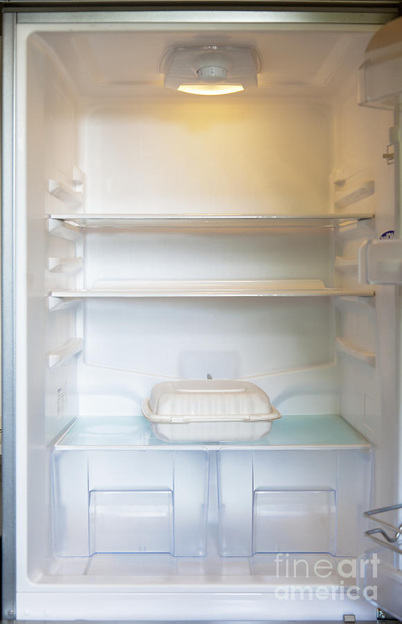 Ajar Photograph - Food Container In A Refrigerator by Inti St. Clair
