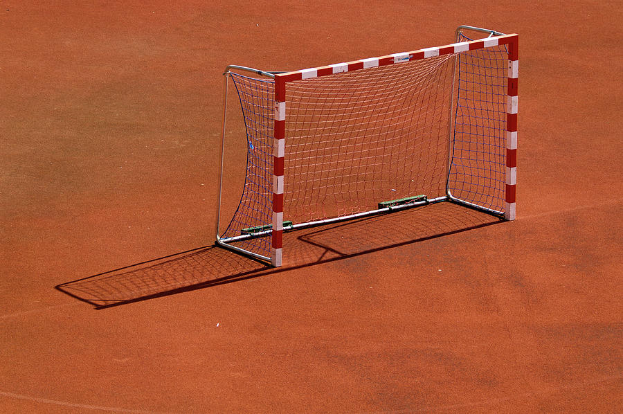 Horizontal Photograph - Football Net On Red Ground by Daniel Kulinski