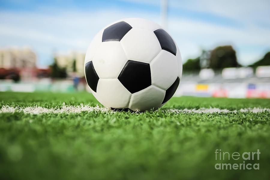 Activity Photograph - Football On Green Grass   by Mongkol Chakritthakool