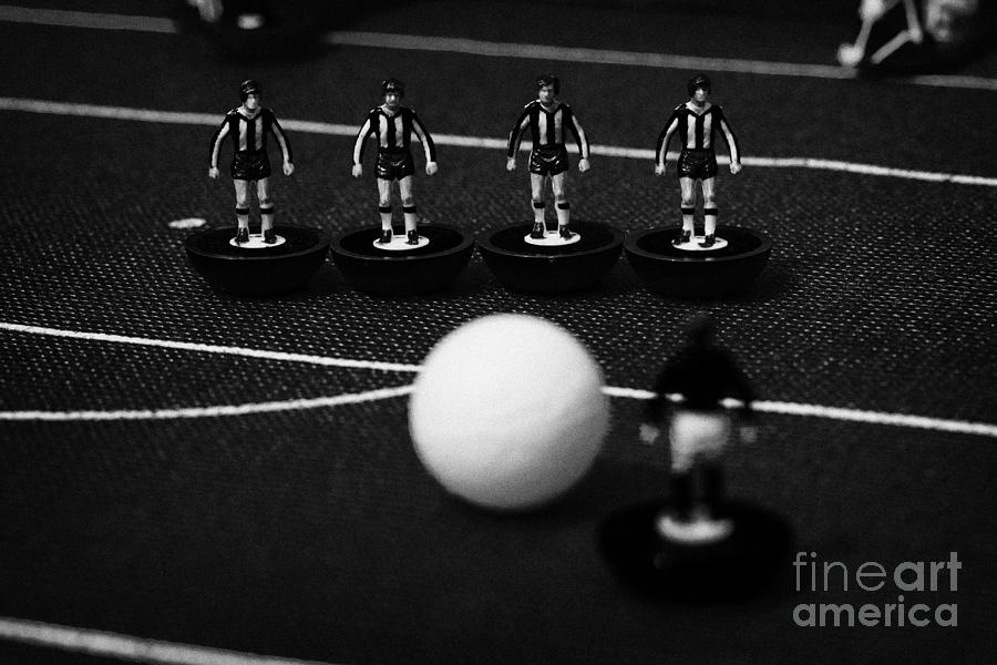 Table Photograph - Free Kick Wall Of Players Football Soccer Scene Reinacted With Subbuteo Table Top Football  by Joe Fox