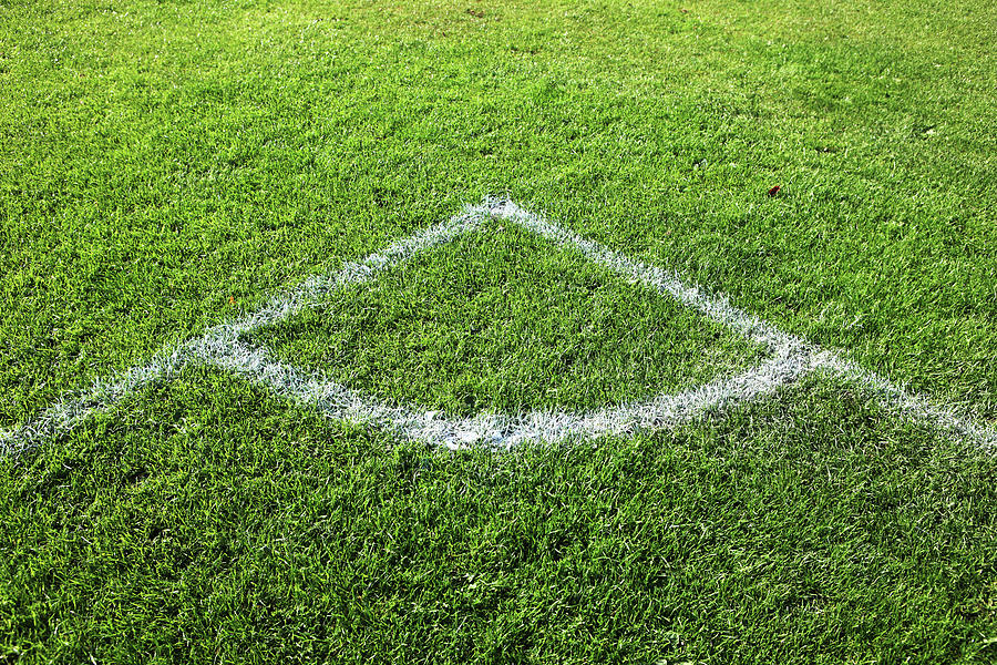 Horizontal Photograph - Freshly Painted Corner Area On Grass by Richard Newstead