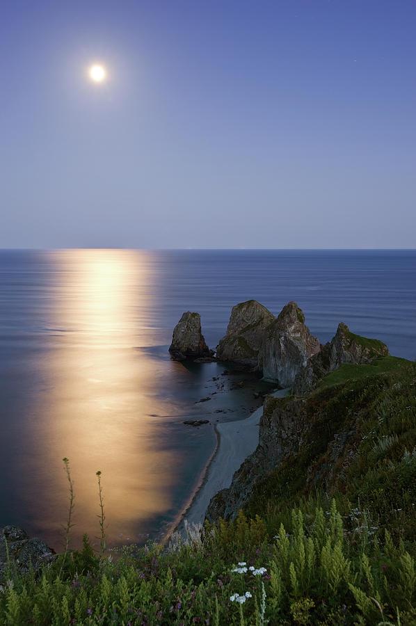 Vertical Photograph - Full Moon On Cape Four Rocks by V. Serebryanskiy