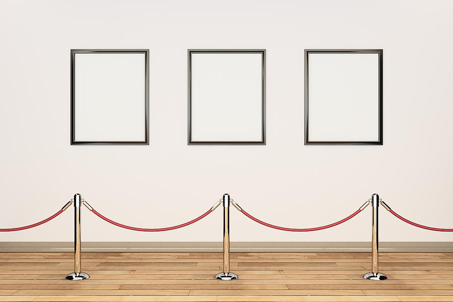 gallery interior with empty frames thumb gallery wall rope barrier and