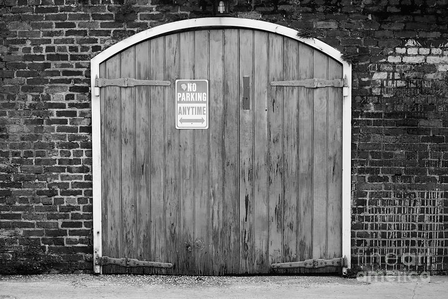 White And Black Garage Doors : Garage door and brick wall french quarter new orleans