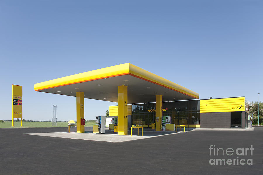 Blue Sky Photograph - Gas Station by Jaak Nilson