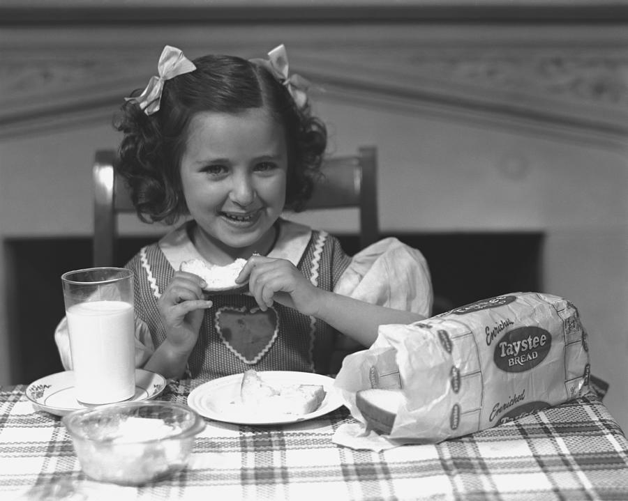 Child Photograph - Girl (4-5) Eating Breakfast, (b&w) by George Marks