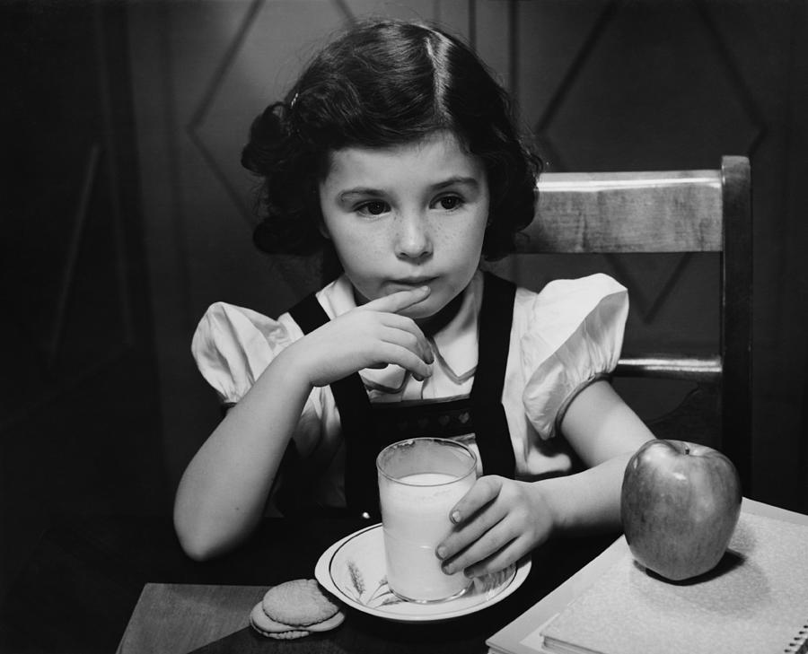 Child Photograph - Girl (6-7) Sitting At Table, Having Breakfast, (b&w) by George Marks