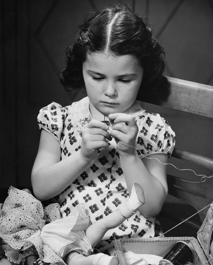 Child Photograph - Girl (6-7) Threading Needle, (b&w) by George Marks