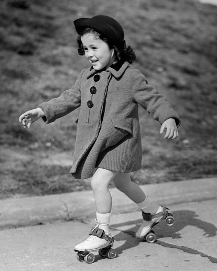 Child Photograph - Girl Roller-skating by George Marks