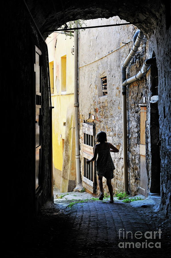 People Photograph - Girl Running Through A Cobblestone Street by Sami Sarkis