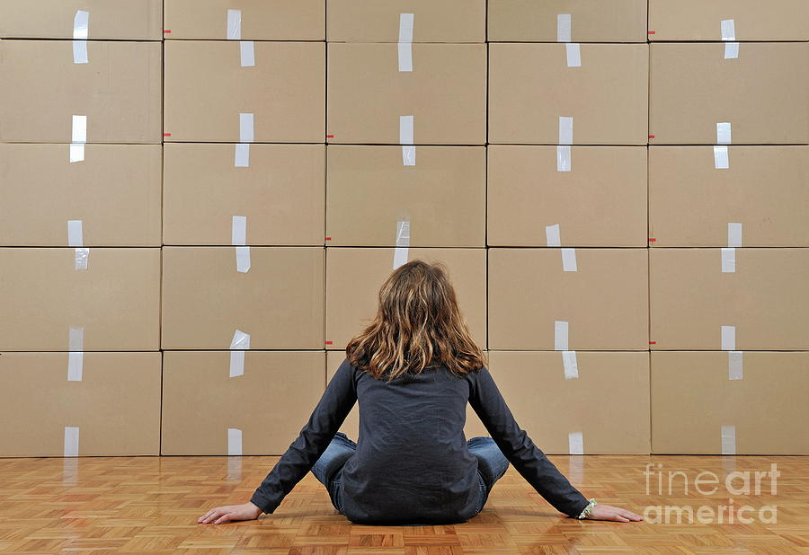 Facing Photograph - Girl Seated In Front Of Cardboard Boxes by Sami Sarkis