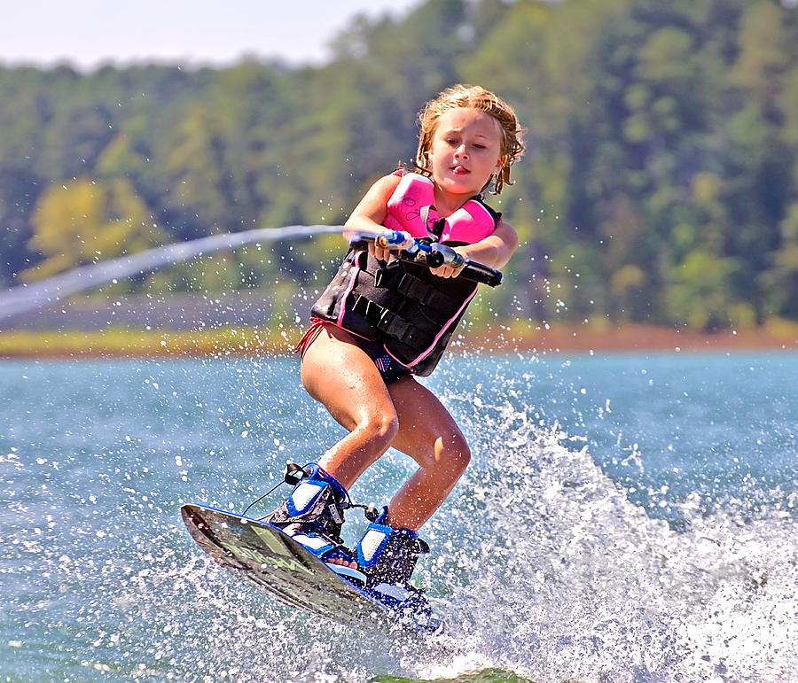 Young Photograph - Girl Trick Skiing by Susan Leggett