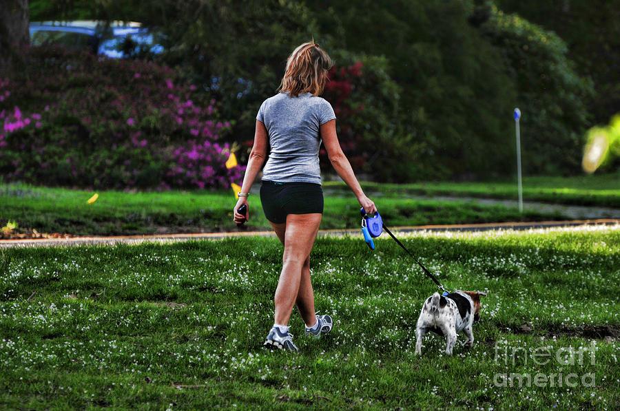 Man Photograph - Girl Walking Dog by Paul Ward