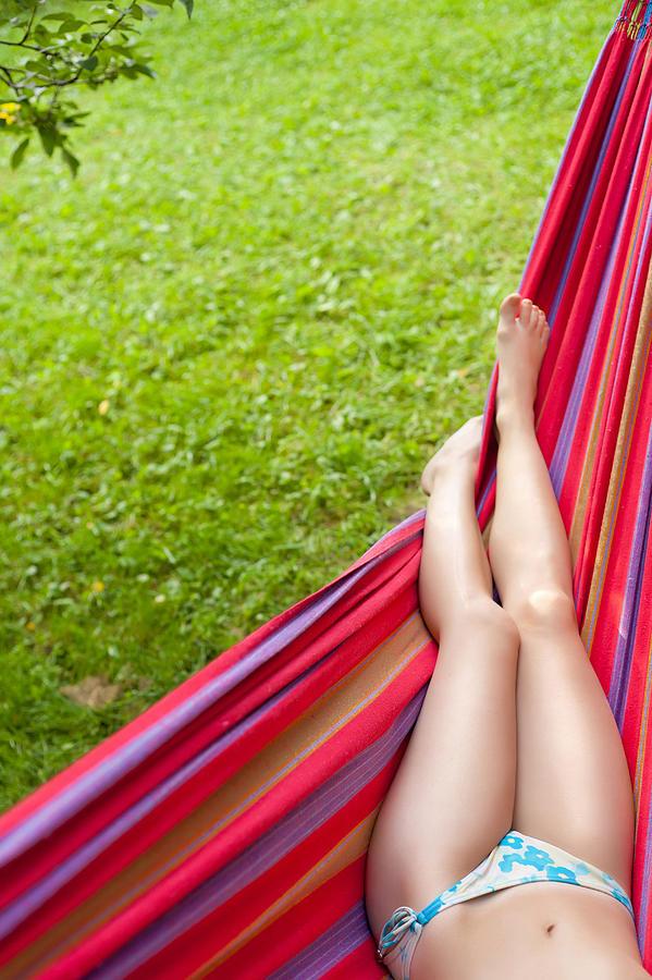 Girl's Legs In A Hammock Photograph by Dmitry Malyshev