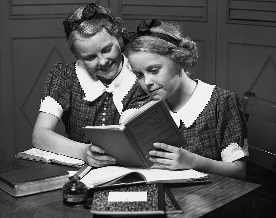 Child Photograph - Girls Studying Tegether by George Marks
