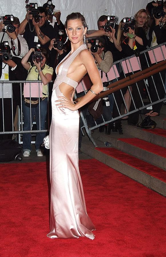 Red Carpet Photograph - Gisele Bundchen Wearing A Versace Gown by Everett