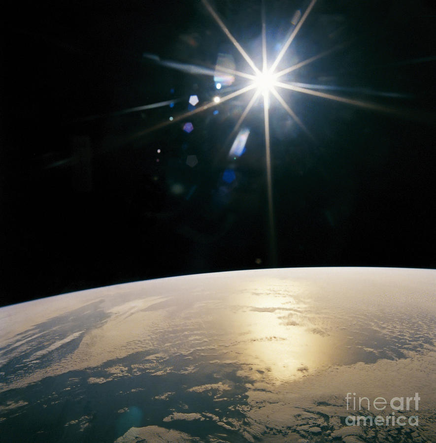 Glowing Star Over Earth Photograph