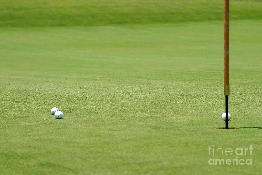 Almost Photograph - Golf Balls Near Flagstick by Henrik Lehnerer