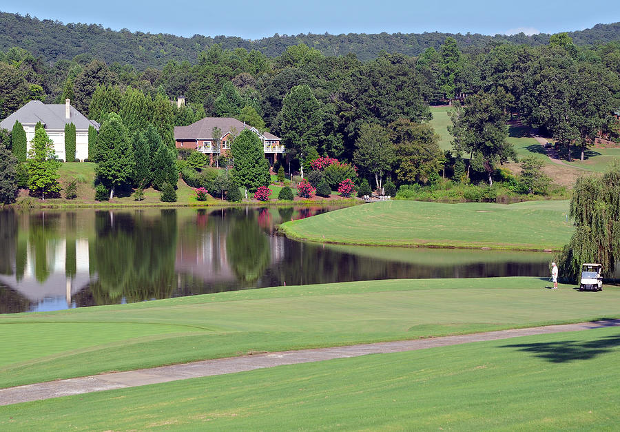 Sport Photograph - Golfer At Lake  by Susan Leggett