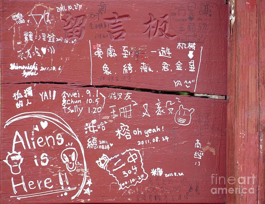 Graffiti Photograph - Graffiti Writing On A Wooden Board by Yali Shi