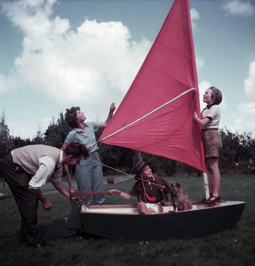 Child Photograph - Grass Boat by A. E. French/Archive Photos