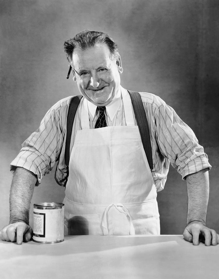 Adult Photograph - Grocery Store Salesman W/can On Counter by George Marks